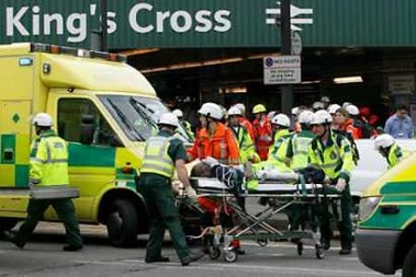 A casualty is taken away on a stretcher at London's King Cross station in London (source: Reuters)